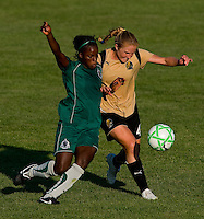 Saint Louis Athletica forward Enoila Aluko (9) and FC Gold Pride defender Rachel Buehler (4) during a WPS match at Anheuser-Busch Soccer Park, in St. Louis, MO, July 26, 2009.  The match ended in a 1-1 tie.