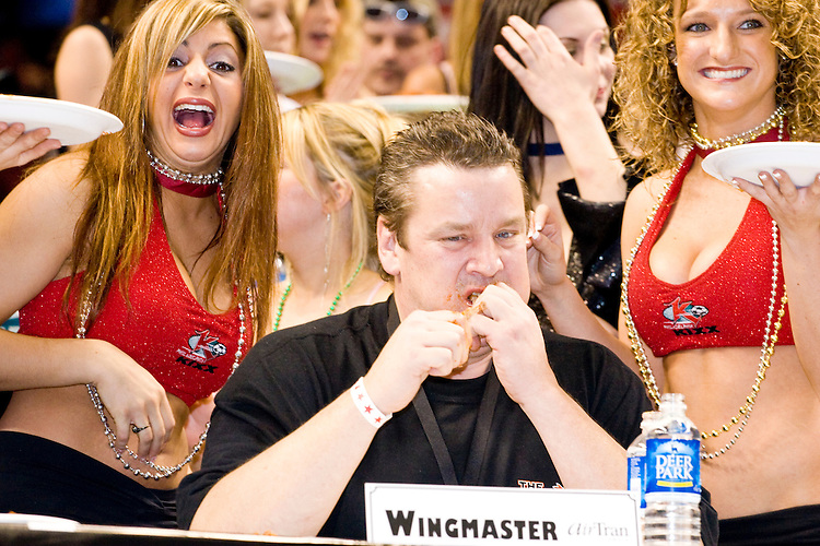 &quot;Wingmaster&quot; at the 14th annual Wing Bowl, held in Philadelphia on February 3, 2006 at the Wachovia Center.<br /> <br /> The Wing Bowl is a competitive eating event in which eaters try and down the most hot wings in 30 total minutes in front of a crowd of 10,000 plus people.  The real show however is all around the eaters, from the various scantily clad women (known as &quot;Wingettes&quot;) that make up eaters' entourages, to the behavior of the fans themselves.