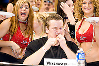 """Wingmaster"" at the 14th annual Wing Bowl, held in Philadelphia on February 3, 2006 at the Wachovia Center.<br /> <br /> The Wing Bowl is a competitive eating event in which eaters try and down the most hot wings in 30 total minutes in front of a crowd of 10,000 plus people.  The real show however is all around the eaters, from the various scantily clad women (known as ""Wingettes"") that make up eaters' entourages, to the behavior of the fans themselves."