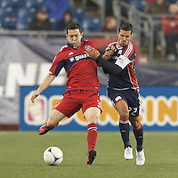 Chicago Fire defender Dan Gargan (3) passes the ball as New England Revolution forward Benny Feilhaber (22) defends. In a Major League Soccer (MLS) match, the New England Revolution defeated Chicago Fire, 2-0, at Gillette Stadium on June 2, 2012.
