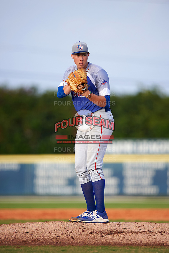 College of Central Florida Patriots starting pitcher Nate Pearson (23) gets ready to deliver a pitch during a game against the SCF Manatees on February 8, 2017 at Robert C. Wynn Field in Bradenton, Florida.  SCF defeated Central Florida 6-5 in eleven innings.  (Mike Janes/Four Seam Images)