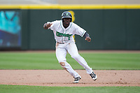Taylor Trammell (5) of the Dayton Dragons takes his lead off of first base against the West Michigan Whitecaps at Fifth Third Field on May 29, 2017 in Dayton, Ohio.  The Dragons defeated the Whitecaps 4-2.  (Brian Westerholt/Four Seam Images)