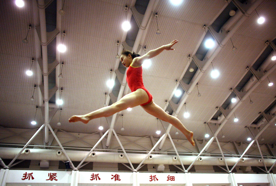 Beijing, China - 14 Feb 2006 - A Chinese gymnast, a member of the national team leaps during training in Beijing.