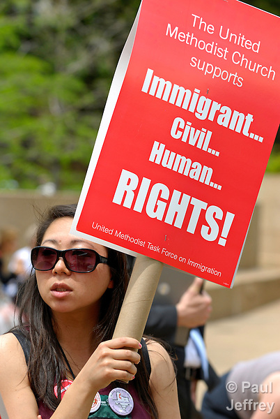 Motoe Yamada holds a sign during an April 23 rally for immigrant rights during the 2008 General Conference of the United Methodist Church. The quadrennial gathering is being held in Fort Worth, Texas.