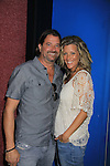 """General Hospital Laura Wright """"Carly"""" poses with her husband John Wright at a Wine Tasting for Standing Sun Wines on August 11, 2012 at MaGooby's Joke House in Timonium, Maryland. The fans got a chance to takes all the various wines, a Q&A, photos, autographs. L(Photo by Sue Coflin/Max Photos)"""