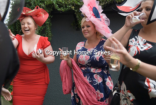 Royal Ascot horse racing Berkshire. 2012 Group of women day out together having fun after the days racing.