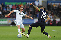 George Byers of Swansea City battles with Bradley Johnson of Derby County during the Sky Bet Championship match between Swansea City and Derby County at the Liberty Stadium in Swansea, Wales, UK. Wednesday 01 May 2019