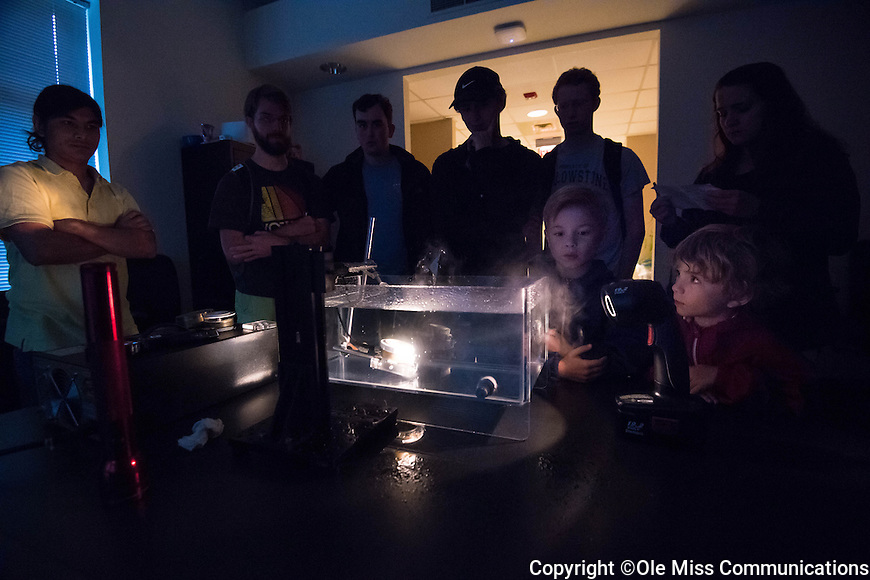 Ukesh Koju, a ph.D. student in Physics, shows what sound can do to water during the open house at the NCPA's 30th anniversary celebration. Photo by Kevin Bain/Ole Miss Communications