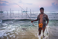 Portrait photo of a stilt fisherman at Midigama near Weligama, South Coast, Sri Lanka, Asia. This is a portrait photo of a stilt fisherman at Midigama near Weligama on the South Coast of Sri Lanka, Asia. This stilt fisherman is continuing a tradition that goes back centuries.