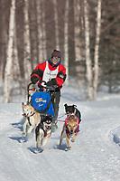 Jill Garnet drives a 4 dog team in the 2009 Limited North American sprint sled dog race, Fairbanks, Alaska.