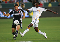 D. C. United defender (6) Greg Vanney clears the ball from the path of Los Angeles Galaxy forward (14) Edson Buddle. LA Galaxy defeated DC United 2-0 in the semifinal of the SuperLiga at the Home Depot Center in Carson, California, Wednesday, August 15, 2007.