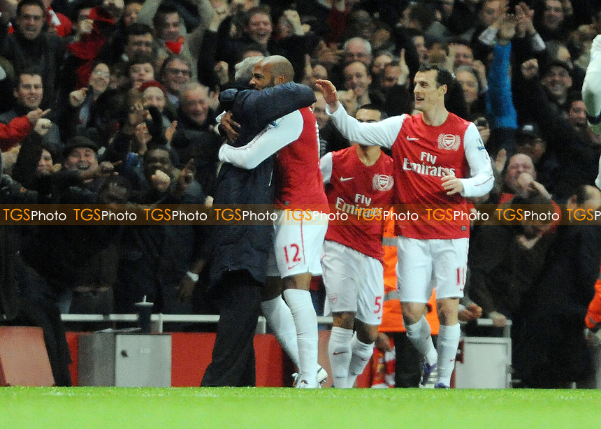 Thierry Henry hugs manager Arsene Wenger after he scores - Arsenal vs Leeds United - FA Cup 3rd Round Football at the Emirates Stadium, London - 09/01/12 - MANDATORY CREDIT: Anne-Marie Sanderson/TGSPHOTO - Self billing applies where appropriate - 0845 094 6026 - contact@tgsphoto.co.uk - NO UNPAID USE.