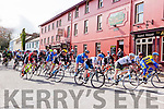 The cyclists arrive into Killorglin town during the final the stage of Ras Mumhan in Killorglin on Monday