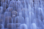 Waterfall over dam in Sabino Creek, Sabino Canyon Recreation Area, Arizona