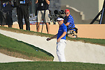 Louis Oosthuizen loses his balance as he lines up his chip at the 18th green during the Final Day of the Dubai World Championship, Earth Course, Jumeirah Golf Estates, Dubai, 28th November 2010..(Picture Eoin Clarke/www.golffile.ie)