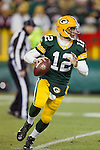 Green Bay Packers quarterback Aaron Rodgers (12) looks for a receiver during a week 16 NFL football game against the Chicago Bears on December 25, 2011 in Green Bay, Wisconsin. The Packers won 35-21. (AP Photo/David Stluka)