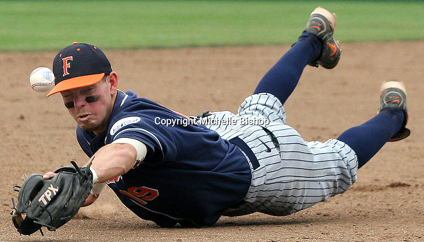 Cal State Fullerton third baseman Evan McArthur has the ball tip off his glove during game five of the 2006 College World Series at Rosenblatt Stadium in Omaha, Neb. (Photo by Michelle Bishop) ..