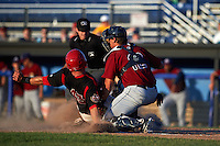Mahoning Valley Scrappers catcher Daniel Salters (12) tags out Korey Dunbar (43) sliding into home as umpire Donnie Smith looks on to make the call during a game against the Batavia Muckdogs on June 24, 2015 at Dwyer Stadium in Batavia, New York.  Batavia defeated Mahoning Valley 1-0 as three Muckdogs pitchers combined to throw a perfect game.  (Mike Janes/Four Seam Images)