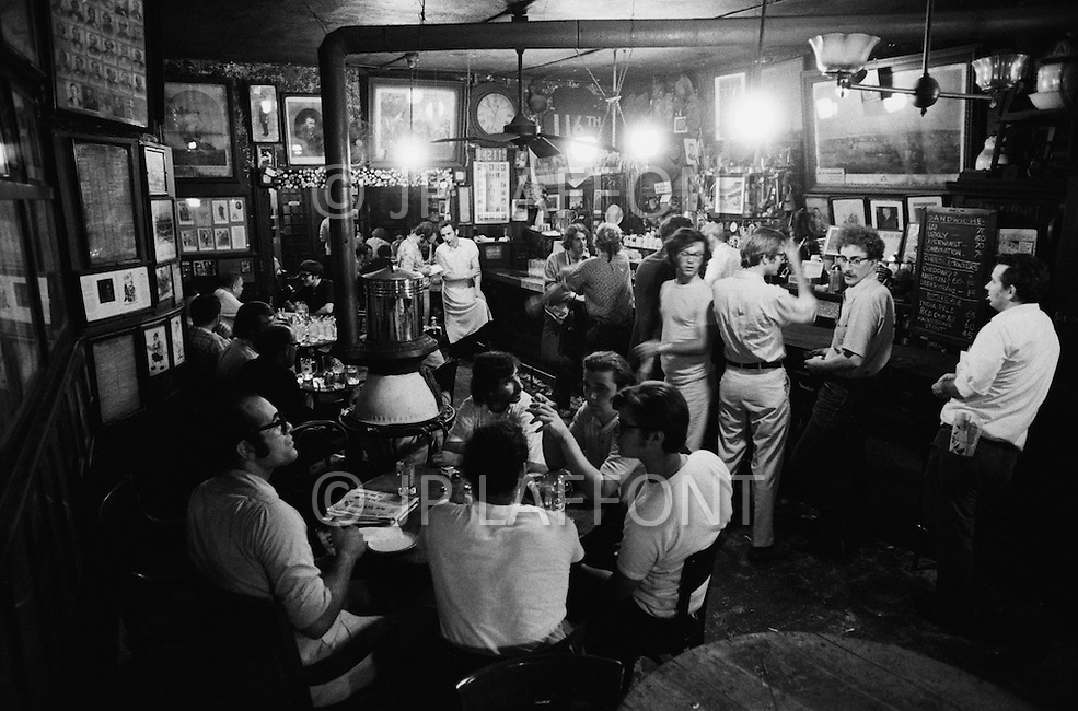August 1970, Manhattan, New York City, New York State, USA --- Men drinking at McSorley's Old Ale House in Manhattan in 1970. McSorley's was New York City's oldest bar and it refused female patrons before 1970. --- Image by © JP Laffont