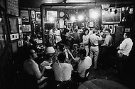 August 1970, Manhattan, New York City, New York State, USA --- Men drinking at McSorley's Old Ale House in Manhattan in 1970. McSorley's was New York City's oldest bar and it refused female patrons before 1970. --- Image by © JP Laffont/Sygma/CORBIS