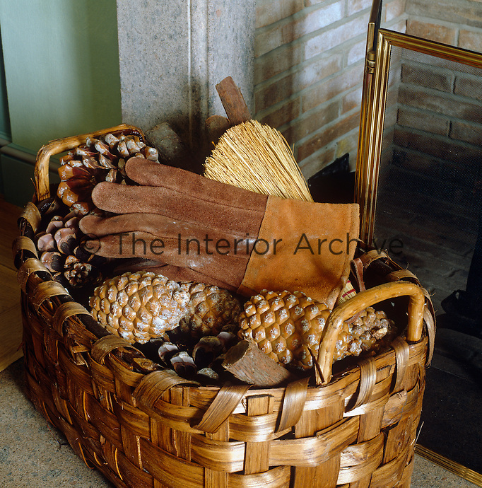 A basket beside the fireplace is filled with fir cones