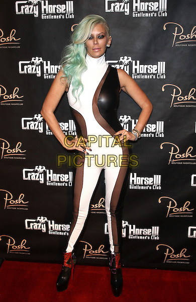 Jenna Jameson.Jenna Jameson celebrates her birthday at Crazy Horse III  Las Vegas, Las Vegas, NV, USA, 23rd March 2013..full length white leather catsuit hands on hips sleeveless see thru through sheer dyed blue green hair red ankle boots heels platform shoes .CAP/ADM/MJT.© MJT/AdMedia/Capital Pictures.