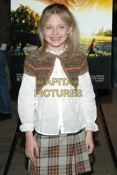 "DAKOTA FANNING.Fathers and Daughters screening of the new film, ""Dreamer"" at the Chelsea West Theater in Manhattan.  .17 October 2005.Ref:ADM/PO.half length knitted bolero white victorian shirt blouse tartan kilt skirt.www.capitalpictures.com.sales@capitalpictures.com.©Patti Ouderkirk/AdMedia/Capital Pictures."