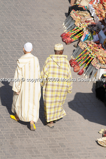 Two men walk through the market in Marrakesh, Morocco.