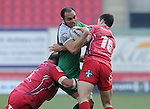 Connacht's George Naoupu is tackled by Scarlets' Peter Edwards and Steve Shingler<br /> <br /> Rugby - Scarlets V Connacht - Guinness Pro12 - Sunday 15th Febuary 2015 - Parc-y-Scarlets - Llanelli<br /> <br /> © www.sportingwales.com- PLEASE CREDIT IAN COOK