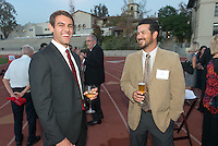John Hansbrough '12 and baseball coach Luke Wetmore. Alumni, family, staff and students at the Occidental College Athletics Hall of Fame event, part of Homecoming weekend, Oct. 24, 2014 on Patterson Field. (Photo by Marc Campos, Occidental College Photographer)