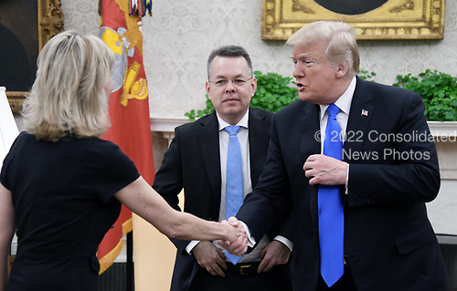 U.S. President Donald Trump meets with Pastor Andrew Brunson and his wife Norine Brunson (L) in the Oval Office of the White House on October 13, 2018 in Washington, DC. Pastor Andrew Brunson arrived back in the U.S. on Saturday after being held in Turkey for two years on terrorism charges. <br /> Credit: Olivier Douliery / Pool via CNP