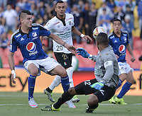 BOGOTA - COLOMBIA -26 -07-2015: Michael Rangel (Izq) jugador de Millonarios disputa el balón con Jose fernando Cuadrado (Der) arquero de Once Caldas durante partido por la fecha 3 de la Liga Águila II 2015 jugado en el estadio Nemesio Camacho El Campín de la ciudad de Bogotá./ Michael Rangel (L) player of Millonarios fights for the ball with Jose fernando Cuadrado (R) goalkeeper of Once Caldas during the match for the third date of the Aguila League II 2015 played at Nemesio Camacho El Campin stadium in Bogotá city. Photo: VizzorImage / Gabriel Aponte / Staff.
