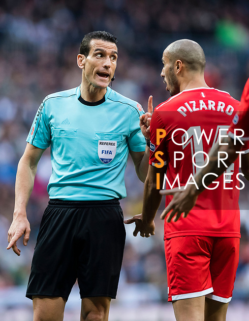 Referee Juan Martinez Munuera (l) speaks to the Guido Hernan Pizarro of Sevilla FC during the La Liga 2017-18 match between Real Madrid and Sevilla FC at Santiago Bernabeu Stadium on 09 December 2017 in Madrid, Spain. Photo by Diego Souto / Power Sport Images