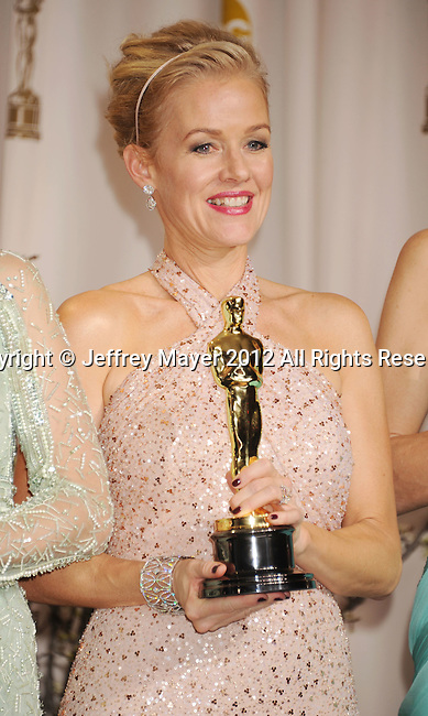 HOLLYWOOD, CA - FEBRUARY 26: Penelope Ann Miller poses in the press room at the 84th Annual Academy Awards held at Hollywood & Highland Center on February 26, 2012 in Hollywood, California.