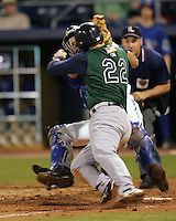 Durham Bulls catcher Hector Gimenez collides with Charlotte Knights 3B Josh Fields on April 22nd, 2008 at Durham Bulls Athletic Park. Photo by Andrew Woolley / Four Seam Images.