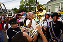 Members of the Baby Doll Sisterhood second line in memory of Baby Doll Tee Eva Perry, who died at 83 on June 7, in New Orleans, La. Monday, June 11, 2018.  James Andrews leads the secondline