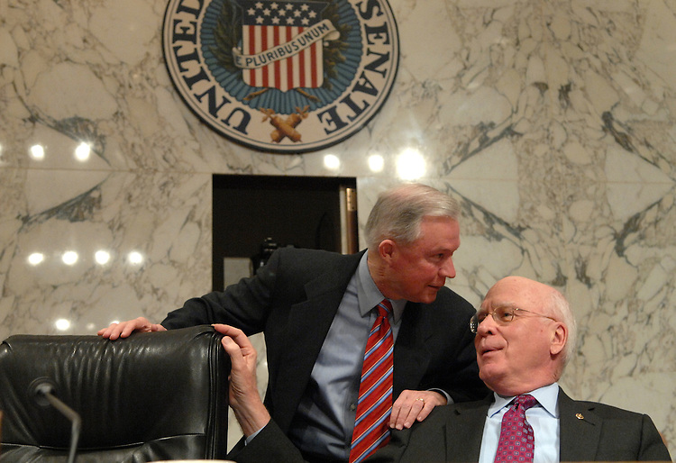 Chairman of the Senate Judiciary Committee Pat Leahy, D-Vt., right, talks with Sen. Jeff Sessions, R-Texas, at a hearing on judicial security and independence.  Supreme Court Justice Anthony Kennedy, testified.