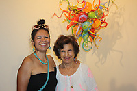 NWA Democrat-Gazette/CARIN SCHOPPMEYER Nora Skattebo (left) and Marina Leon attend the opening reception.