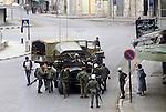 Nablus West Bank Israel. Israeli soldiers lead Palestinian man away ( in brown jacket left of image) Palestinian women remonstrate with soldiers. 1980s Middle East