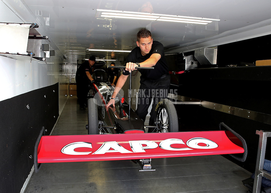 Apr. 26, 2013; Baytown, TX, USA: NHRA crew members for top fuel dragster driver Steve Torrence unload the car from the teams hauler during qualifying for the Spring Nationals at Royal Purple Raceway. Mandatory Credit: Mark J. Rebilas-