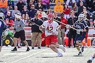 College Park, MD - April 8, 2017: Maryland Terrapins Curtis Corley (42) avoids a Penn State Nittany Lions defender during game between Penn State and Maryland at  Capital One Field at Maryland Stadium in College Park, MD.  (Photo by Elliott Brown/Media Images International)