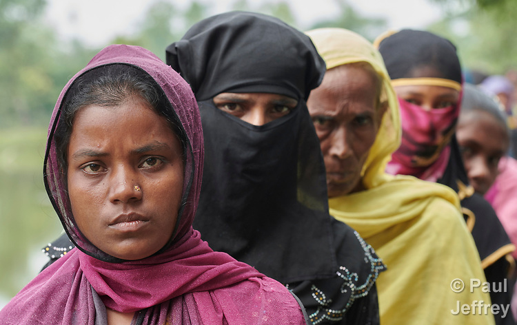 Rohingya refugee women line up to receive food from ICCO Cooperation in the Chakmarkul Refugee Camp near Cox's Bazar, Bangladesh, where ICCO and other members of the ACT Alliance provide a variety of humanitarian support for the refugees. <br /> <br /> More than 600,000 Rohingya have fled government-sanctioned violence in Myanmar for safety in Bangladesh.