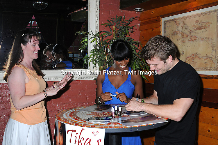 One Life to Live actors Tika Sumpter and Mark Lawson..and a fan..at Tika Sumpter's Fan Club Event on August 17, 2008 ..at The Havana Room in New York City. The event raised money for Feed The Children and Harlem Dowling. ....Robin Platzer, Twin Images