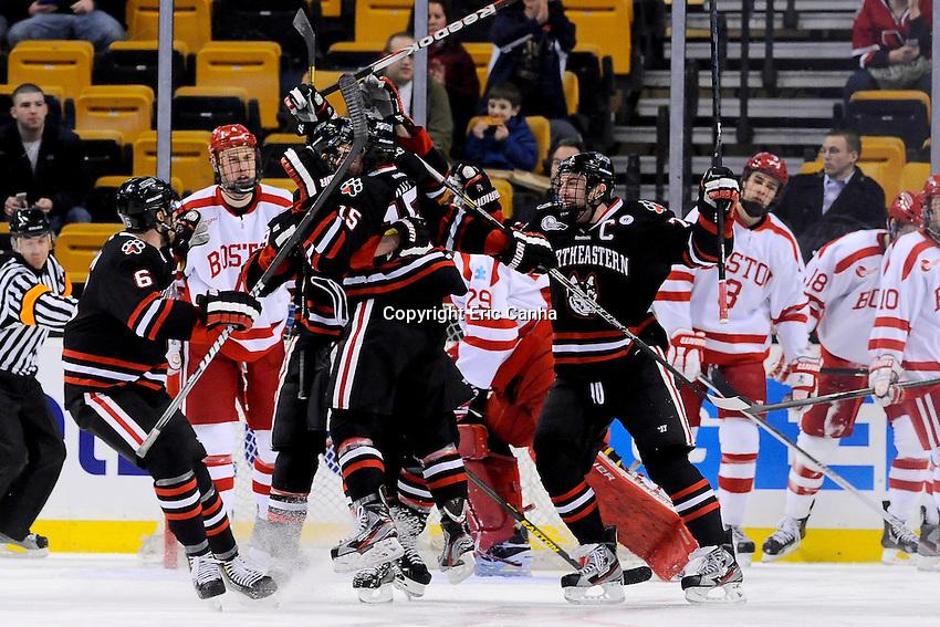 during the first semi-final Beanpot Tournament hockey game between Boston University and Northeastern University held at TD Garden in Boston Massachusetts.  Eric Canha/CSM