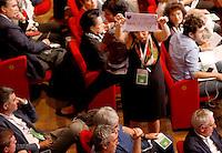 Una delegata mostra un cartello durante le votazioni nella seconda giornata dell'Assemblea Nazionale del Partito Democratico a Roma, 21 settembre 2013.<br /> Delegates vote during the second day of the Italian Democratic Party's National Assembly in Rome, 21 September 2013.<br /> UPDATE IMAGES PRESS/Riccardo De Luca