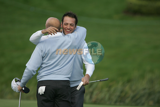 Nick Dougherty embraces Graeme Storm after their win on the 18th green during the first round of the Seve Trophy at The Heritage Golf Resort, Killenard,Co.Laois, Ireland 27th September 2007 (Photo by Eoin Clarke/GOLFFILE)