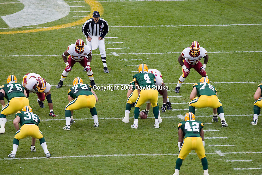 Linebackers Rocky McIntosh #52 and London Fletcher #59 of the Washington Redskins wait for quarterback Brett Favre #4 of the Green Bay Packers to receive the snap at Lambeau Field on October 14, 2007 in Green Bay, Wisconsin. The Packers beat the Redskins 17-14. (Photo by David Stluka)
