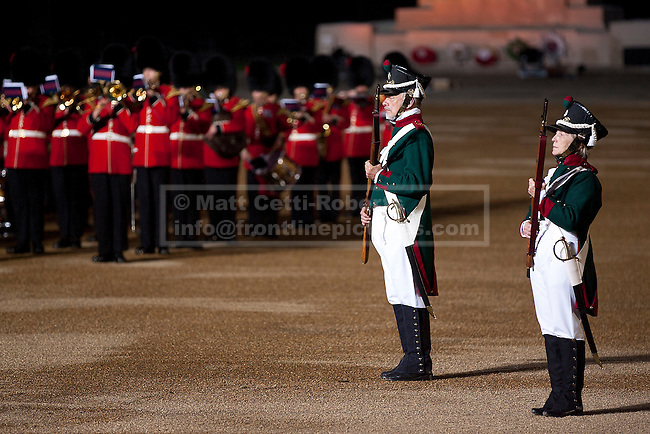 13/06/2012. LONDON, UK. Re-enactors of the 'Moscow Militia' stand in line during a performance of Tchaikowsky's '1812 Overture' at the annual Beating Retreat parade at Horse Guards Parade in London. On two successive evenings each year in June a pageant of military music, precision drill and colour takes place on Horse Guards Parade in the heart of London when the Massed Bands of the Household Division carry out the Ceremony of Beating Retreat. 300 musicians, drummers and pipers perform this age-old ceremony. The Retreat has origins in the early days of chivalry when beating or sounding retreat pulled a halt to the days fighting. Photo credit: Matt Cetti-Roberts