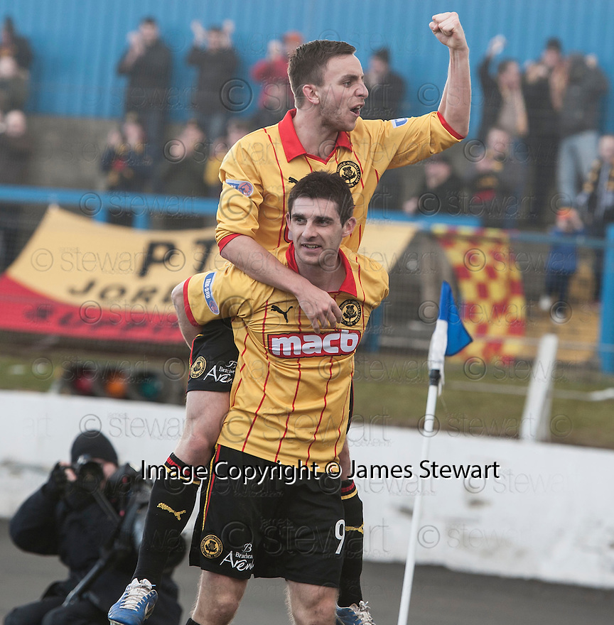 Thistle's Kris Doolan is congratulated by Steven Lawless after he scores their second goal.