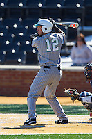 Eric Escobedo (12) of the Marshall Thundering Herd at bat against the Georgetown Hoyas at Wake Forest Baseball Park on February 15, 2014 in Winston-Salem, North Carolina.  The Thundering Herd defeated the Hoyas 5-1.  (Brian Westerholt/Four Seam Images)